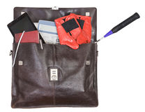 Open briefcase with business and sport items Stock Photo