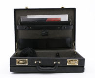 Open briefcase from documents and black cap inside Stock Images
