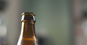 Open brown beer bottle closeup Royalty Free Stock Images