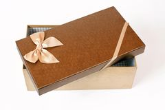 Open brown gift box with ribbon bow, isolated on white royalty free stock photography
