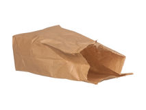Open brown paper bag laying down isolated on white Stock Photos