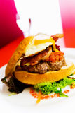 Open burger on a white plate Stock Photos