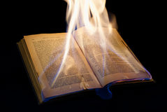 Open burning book with black background Stock Photography