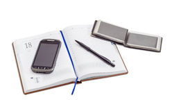 Open business diary, wallet for business cards, pen, mobile phon Stock Images