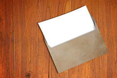 Open Business Envelope. Blank white paper on wood background Royalty Free Stock Photography