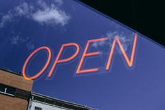 An open neon business sign stock image