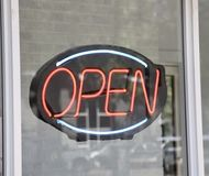 Open for Business. A sign in a window lets consumers, customers or patrons this business is in its hours of operations Royalty Free Stock Photography