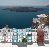 Open cafe in front of the Santorini lagoon. Royalty Free Stock Photo