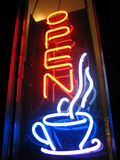 Open Cafe Neon Sign. Neon cafe sign is lit in the night Stock Photo