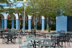 Open cafe at resort. A view of an open air cafe at a resort with unoccupied chairs and tables Royalty Free Stock Image