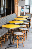 Open cafe terrace, round tables and wicker chairs, Paris, France Royalty Free Stock Photo