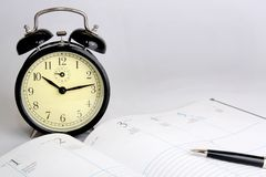Open calendar and alarm clock Royalty Free Stock Images