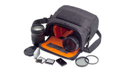 Open camera bag, photo lenses and some photo accessories Royalty Free Stock Image