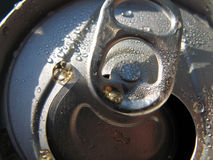 Open Can Closeup. Closeup on the tab top of an open soda can, with droplets of the soda and water condensation on top Stock Photography