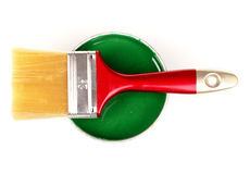 Open can of green paint and brush Royalty Free Stock Photos