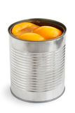 Open can of peach halves in syrup. Stock Photo