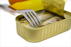 Open can of sardines with fork Royalty Free Stock Images
