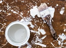 Open can of white paint with brush on wooden background Royalty Free Stock Images