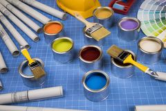 Open cans of paint,Brush, blue background royalty free stock images