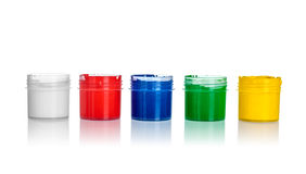 Open cans of paint, yellow, green, blue, red, white colors Royalty Free Stock Photos