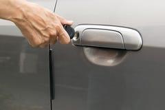 Open car door with key Stock Photo