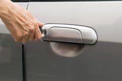 Open car door with key Stock Images