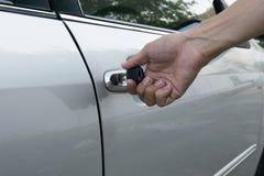 Open car door with key Stock Photography