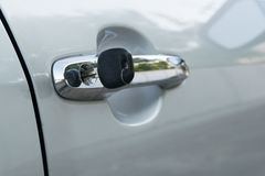 Open car door with key Royalty Free Stock Image