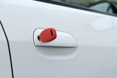 Open car door with red key Stock Image