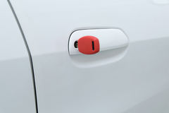 Open car door with red key Royalty Free Stock Images