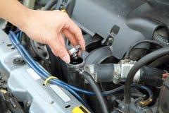 Open the car radiator valve Royalty Free Stock Image