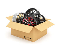Open cardboard box with car rims Royalty Free Stock Photos