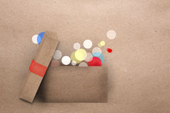 Open cardboard box with colorful lights Royalty Free Stock Photography