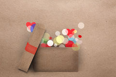 Open cardboard box with colorful lights Royalty Free Stock Photos