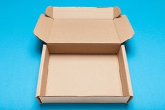 Open cardboard box, free delivery package, top view.  royalty free stock photo
