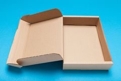 Open cardboard box, free delivery package, top view.  stock photos