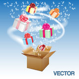 Open cardboard box with an a gifts. Royalty Free Stock Images