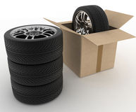 Open Cardboard Box with Tires on white Stock Photo