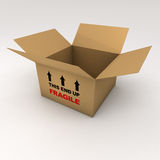 An open cardboard box with the word fragile Stock Photo