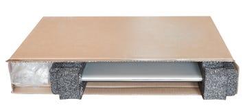 Open carton box with new laptop Royalty Free Stock Photo