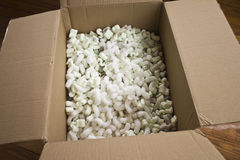 Open Carton with packing peanuts Royalty Free Stock Photo