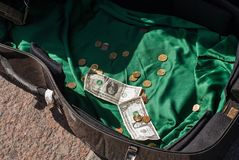 Open case of the cello with coins and bills Royalty Free Stock Images