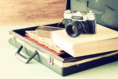 Open case with old camera sunglasses and clock stock images