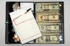 Open cash box on white Royalty Free Stock Images