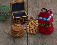 Open casket, red gift bag, forest nutlets and linking of cookies Royalty Free Stock Image