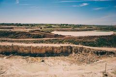 Open cast limestone yellow mining quarry landscape Royalty Free Stock Photo