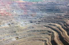 Open cast mine. Close up of quarry with excavators and locomotives Royalty Free Stock Image