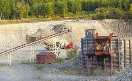 Open-cast mine on mining operations in wood Stock Photos