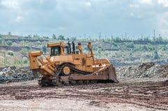 Open cast mine. Picture of a big yellow bulldozer in open cast mine Stock Image