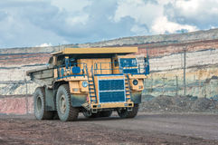 Open cast mine. Picture of big yellow heavy truck in open cast mine Stock Image